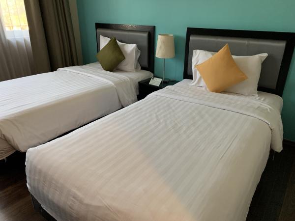 立地抜群のホテル The Brunei Hotel ベッドルーム