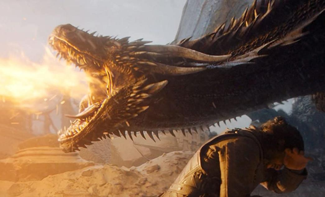 玉座を炎で溶かすドラゴン