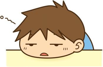 眠くて机の上でぐだっとしている男の子のイラスト