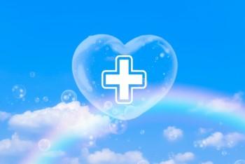 虹のかかった青空にハートのシャボン玉と白い十字架