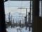 射水市(旧新湊市)内の万葉線軌道越しに立山連峰を望む之圖