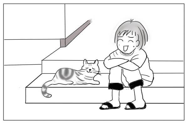 玄関で猫とくつろぐ