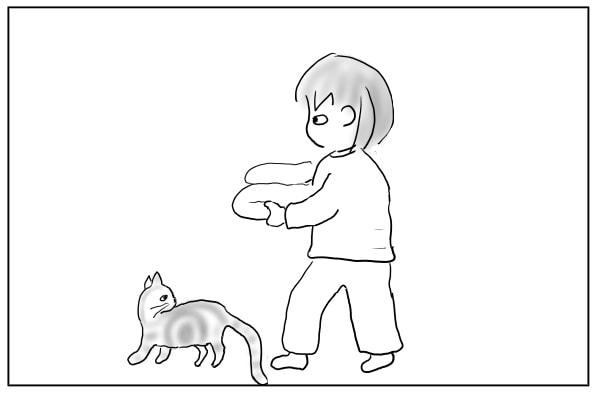猫と歩く女