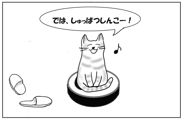 お掃除ロボットに乗る猫