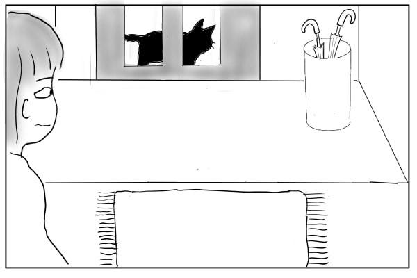 ドアのはめ込みガラスにうつる猫