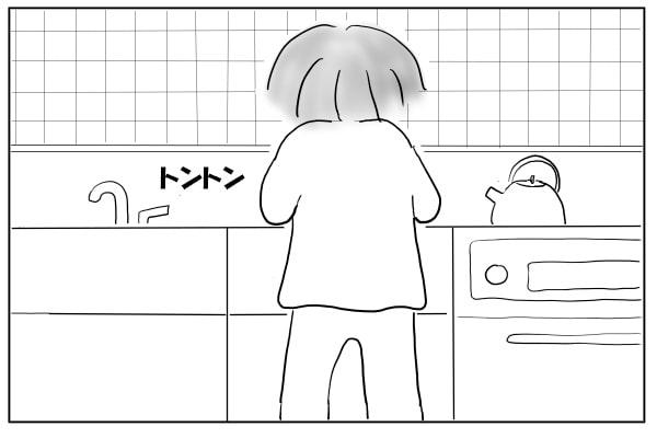 料理する妻