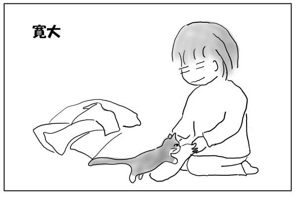 よじ登ろうとする猫