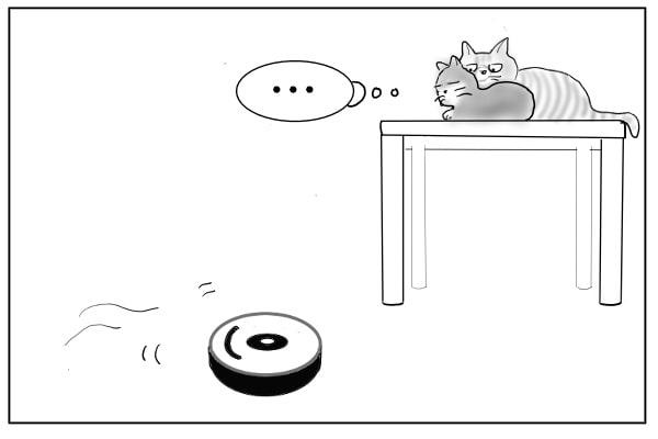 テーブルにのぼる猫