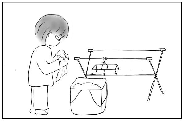 洗濯物を干す人
