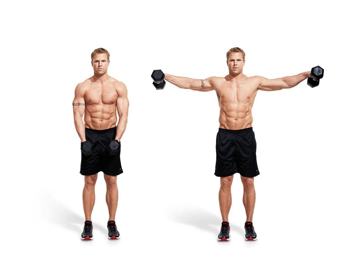 肩トレーニングのサイドレイズをしている男性