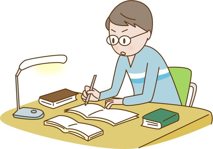 机に向かって情報を集めるコンビニバイト