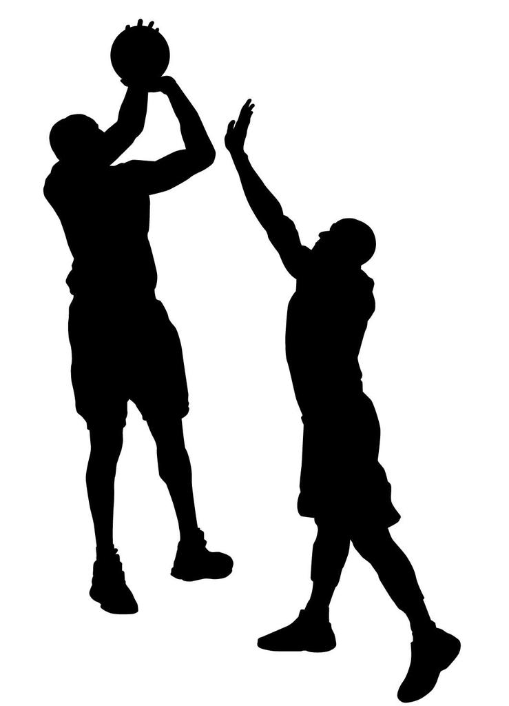 バスケットボールで3ポイントシュートを打つ人