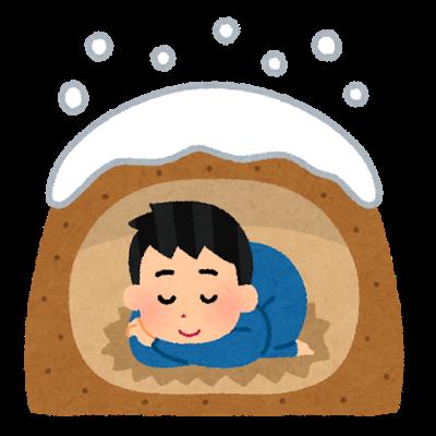 雪降る下で、かまくらのようなところで寝ている男子