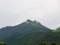 雲を頂いた由布岳