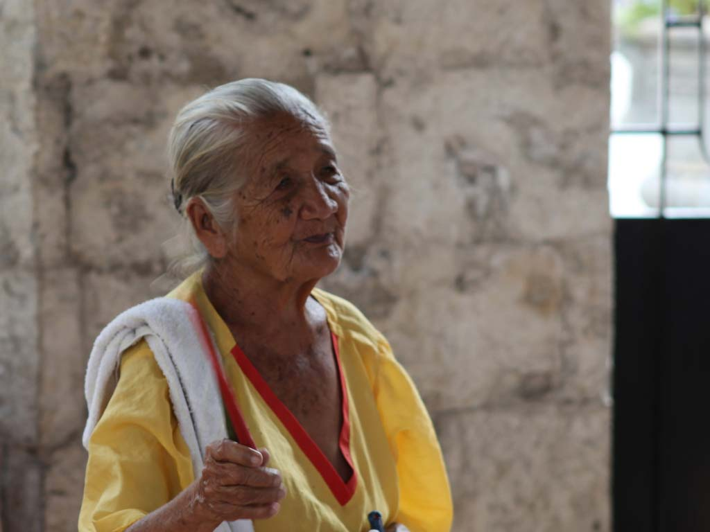 Dancing old women at Magellan Cross