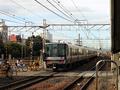 北宮原踏切と快速列車
