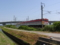 羽越本線・茨野踏切から羽越本線上り 228D