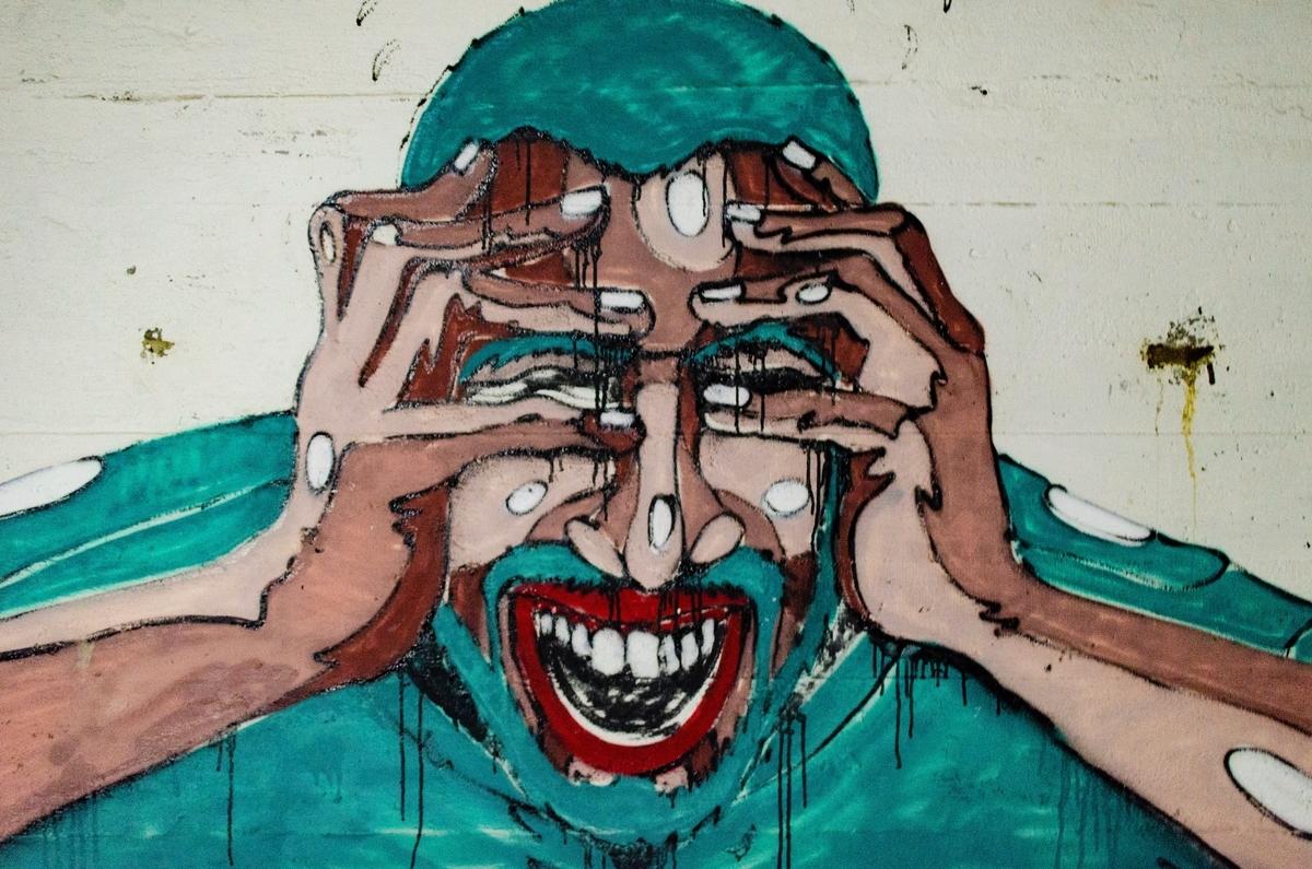 頭を抱える人のイラスト