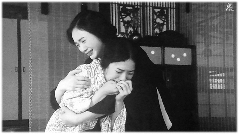 Hanako breaks down crying. Renko gets her arm around Hanako.