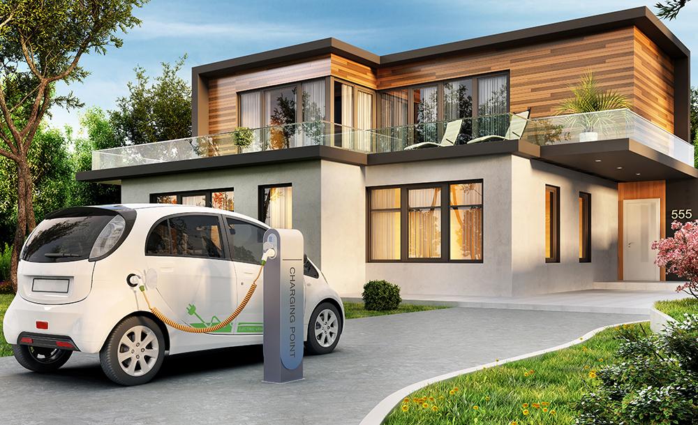 一軒家と充電をする電気自動車(EV)