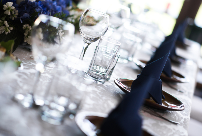 Wedding table. Close-up of folded napkin and empty glasses