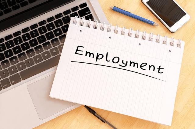 Employment - handwritten text in a notebook on a desk - 3d render illustration.