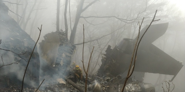 The wreckages of a crashed South Korea's air force F-15K fighter jet remain at a mountain in Chilgok, South Korea