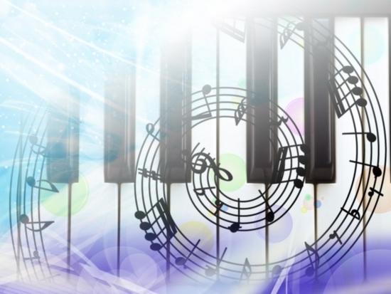 ピアノの鍵盤の上にうずまく音符