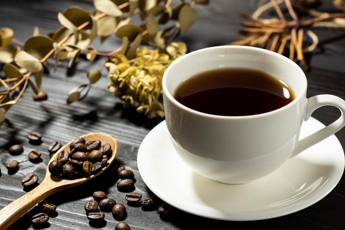 コーヒー豆とコーヒーの画像