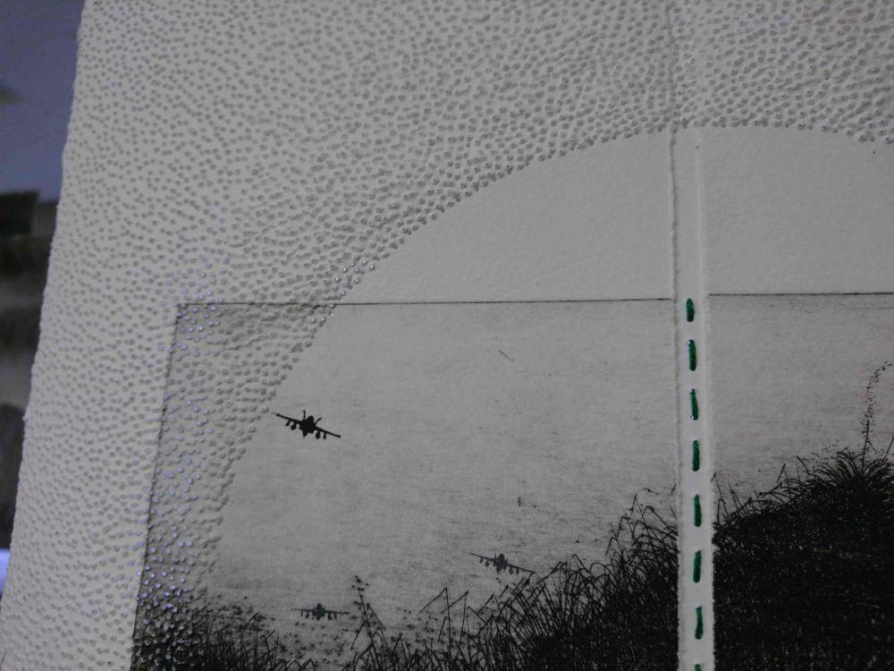 突き刺された紙