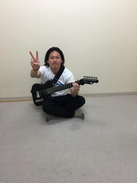 多弦ギターの阪上直樹の写真