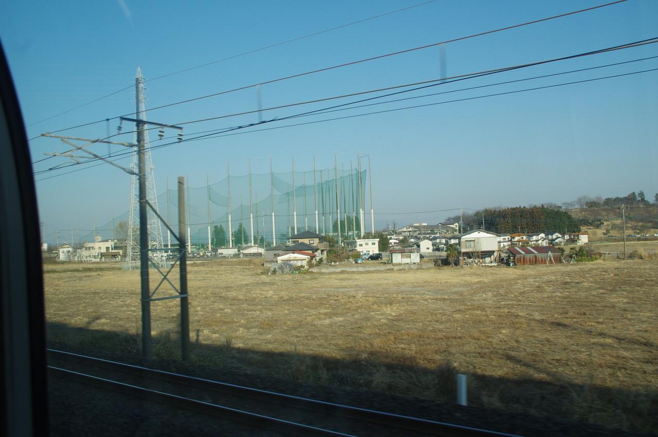 ゴルフセンターと田畑