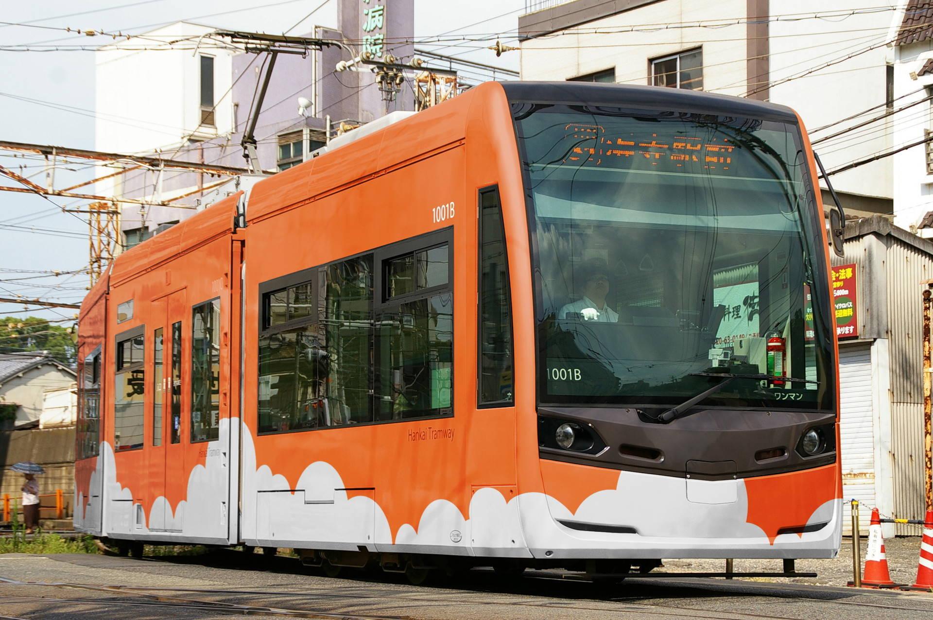 オレンジ色の雲塗装の堺トラム(ウソ電)