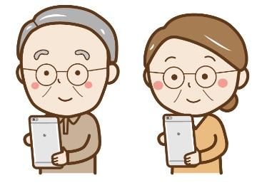 祖父母がメールをしている画像