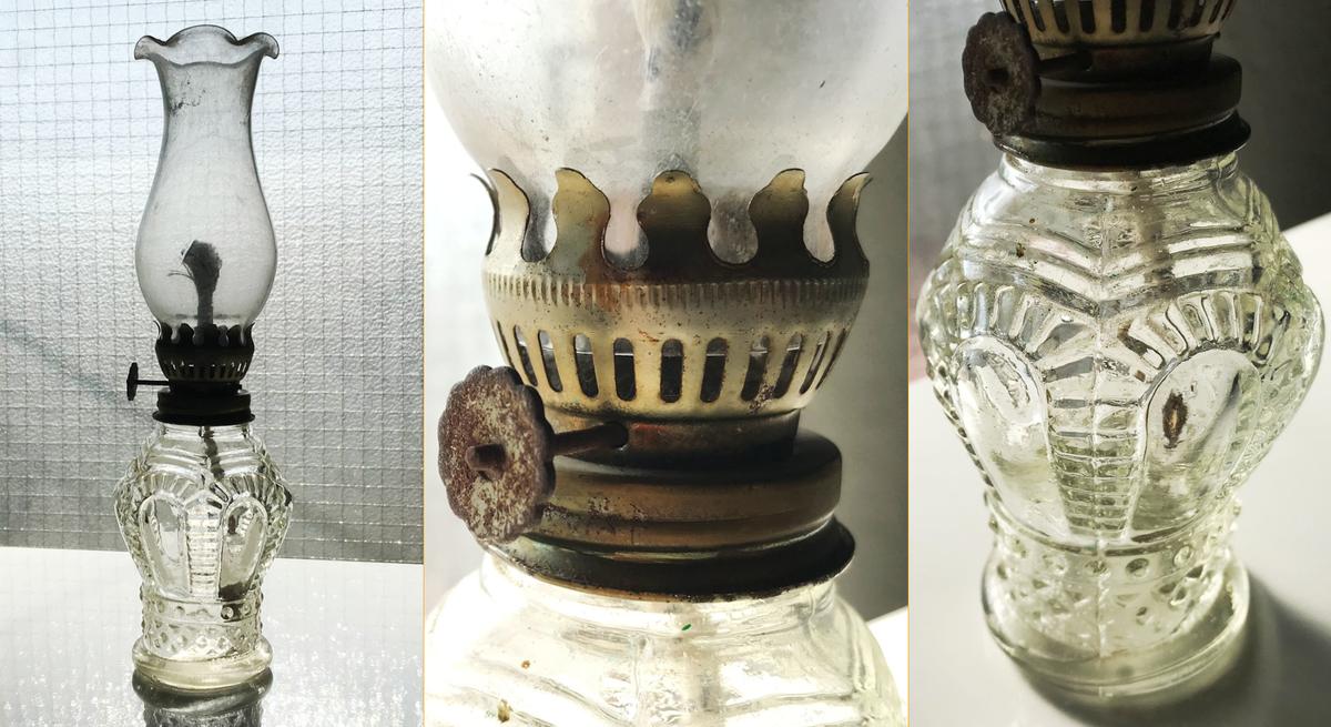 長年の汚れや錆びなどが目立つガラス製の豆ランプ|オイルランプ