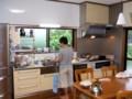 2010年6月25日-Yoshiが台所で何やら料理をつくってます