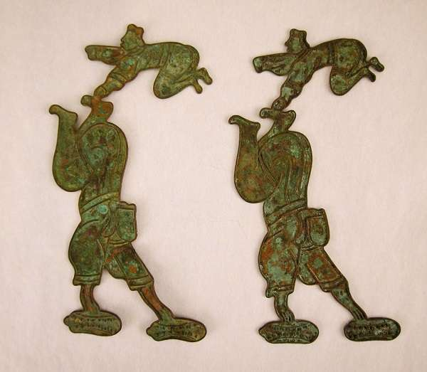 Pair of plaques showing acrobatsFreer