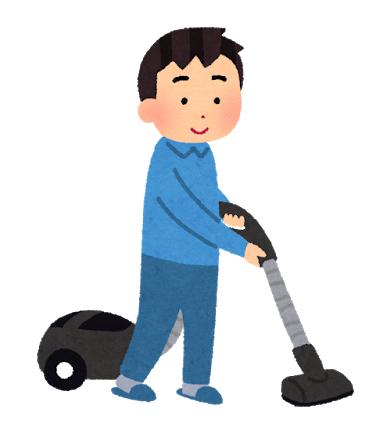 掃除機をかける男