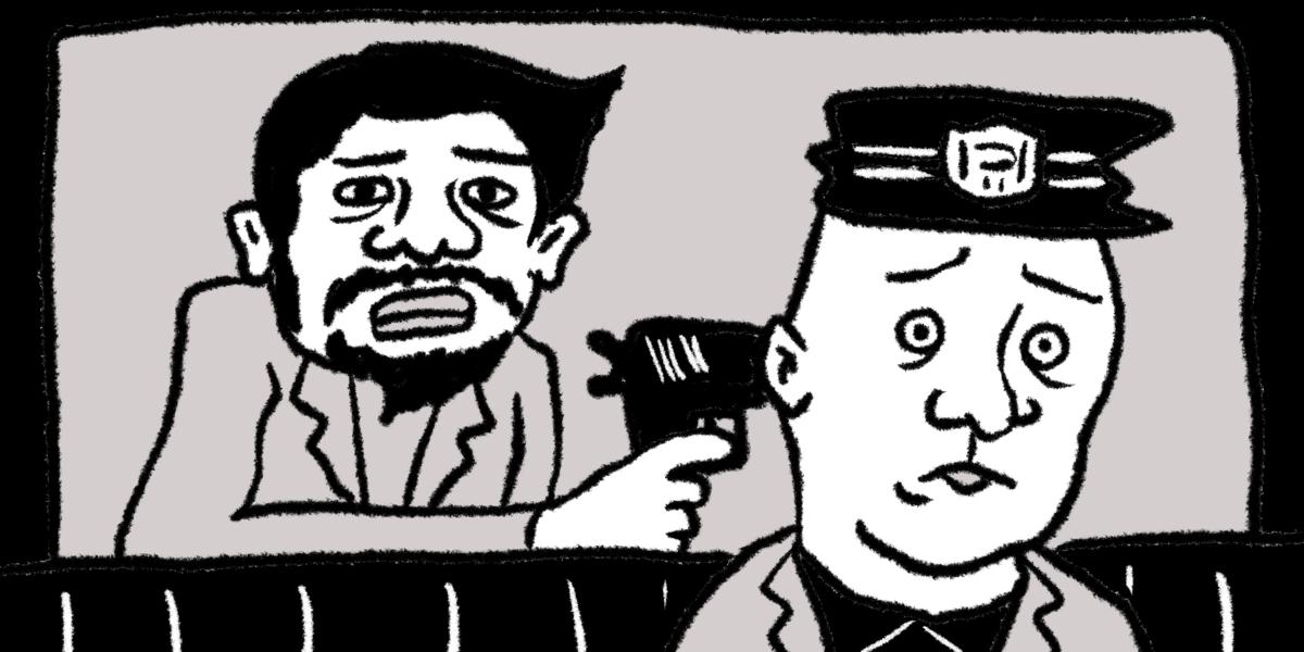 銃口を突き付けられる警察官