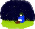 夜の草原、体操座り