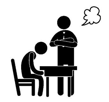 教師に注意を受けている生徒