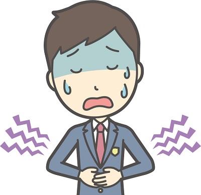 腹痛に苦しむ男子高校生