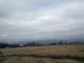 作業で停車中の軽トラ‥雲にかすむ北帰行の白鳥