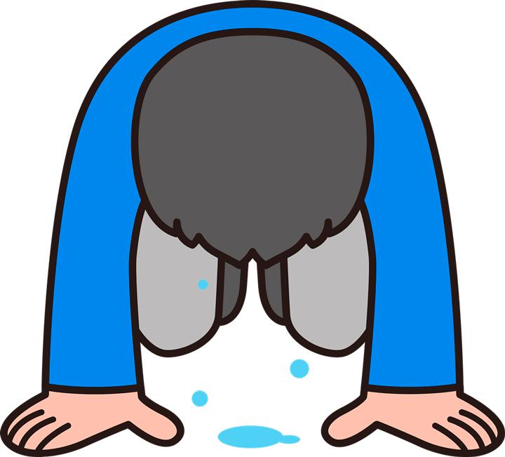 涙を流して土下座する男性
