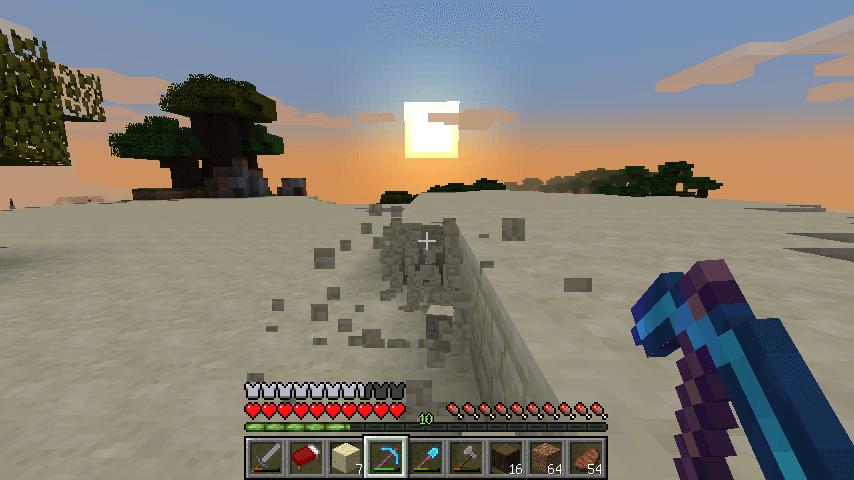 夕日の中砂岩を掘る