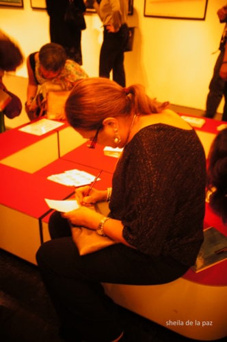 Exhibit guests doing their drawings