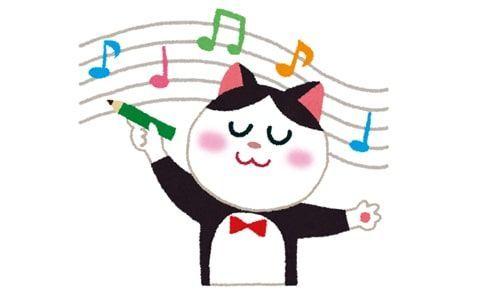 楽しそうな猫と譜面のイラスト