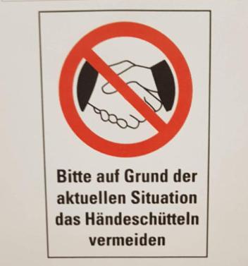 Firmen verbieten wegen Virus das Händeschütteln