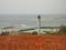 久米島の畑と製糖工場の煙突