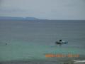 与論島から沖縄本島辺戸岬を望む